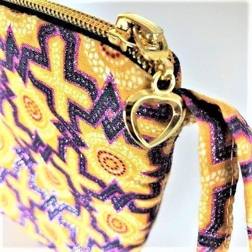 Flot guldfarvet lynlås på clutch Lea - fra Mitomito