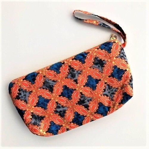 Clutch Ava med orange og blå farver fra Mitomito