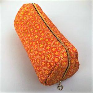 Toilettaske Sonia i orange print med glimmer fra Mitomito