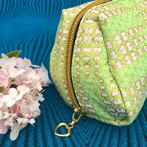 Makeup-pung Ava med glimmer og guldlynlås fra Mitomito
